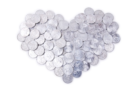 Heart made of silver coins, shot in studio isolated on white photo