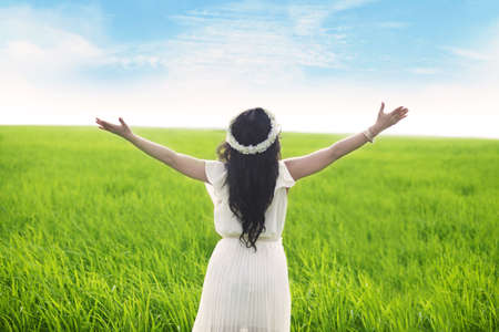 worship praise: Freedom: Woman with opened arms enjoying the view