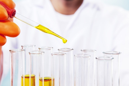 clinical research: Close up shot of scientist working with chemicals Stock Photo