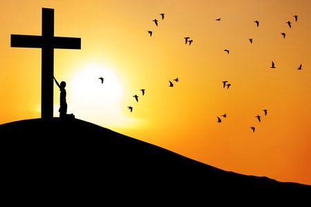 kneel down: Christian background: Silhouette of a man worship the cross at sunrise or sunset