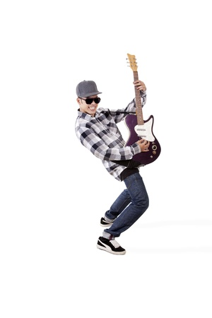 Young asian guitarist playing guitar. shot in studio isolated on white photo