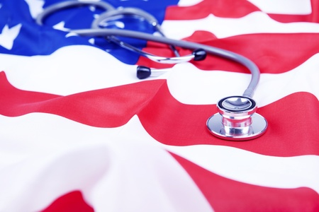 Photo of American flag and stethoscope  illustrating American healthcare issues photo