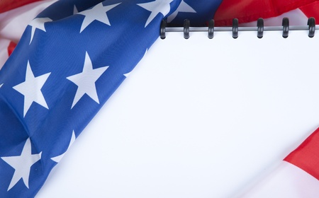 Closeup photo of American flag with blank scrapbook for your own text photo