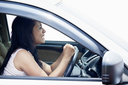 Closeup of a female driver making an angry fisted gesture photo