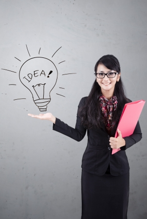 charming business lady: Asian business woman presenting idea. Shot over white board Stock Photo