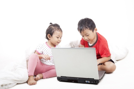 Young asian sibling using laptop, shot in studio isolated on white Stock Photo - 14683000
