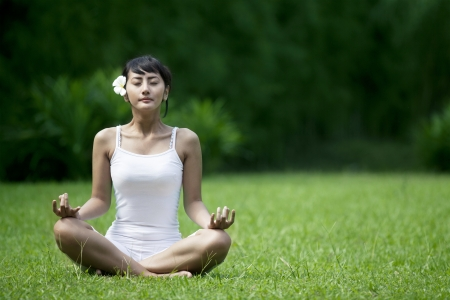 Asian woman in yoga position shot outdoor during summer Stock Photo - 14684475