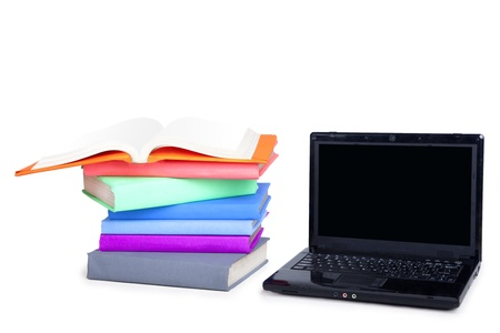 Laptop Computer and Stack of Books. Shot in studio isolated on white photo