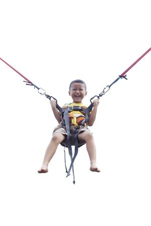 bungee jumping: Ni�o saltando en la cama el�stica (bungee jumping)
