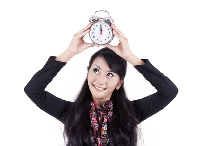 Beautiful businesswoman holding up an alarm clock that says it is break time photo