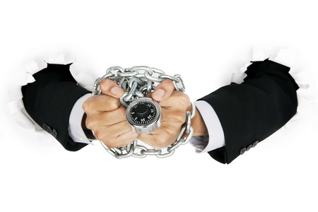 Businessman hand handcuffed by padlock and chain, can be used as symbol a suspect of illegal business Stock Photo - 14659517