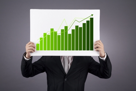 Businessman showing a green graphic of his business growth. shot in studio photo