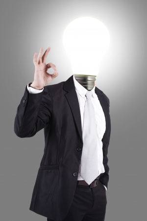 Closeup of business male with lamp-head in suit shows OK  Stock Photo - 14659518