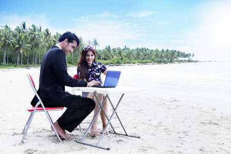 Casual Asian business people having a meeting on the beach Stock Photo - 14686676
