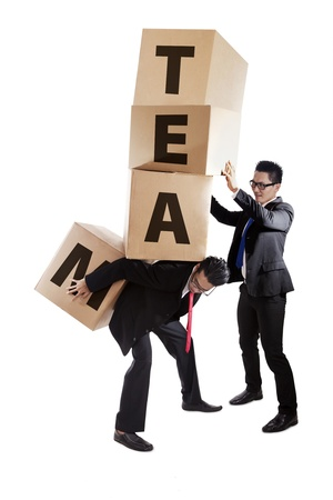An assistant help his partner to carry heavy stack of boxes shot in studio isolated on white photo