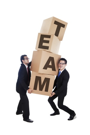 Business people working together in a team carrying cardboxes isolated on white photo