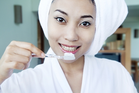 Portrait of beautiful asian woman about to brush her teeth photo