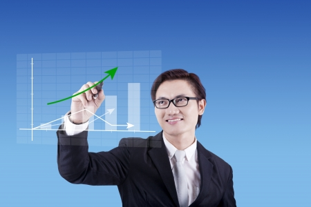 Young success businessman drawing business chart  photo