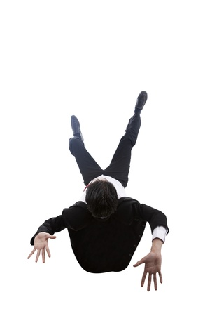 Shot of businessman falling down. shot in studio isolated on white photo