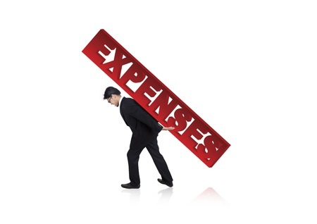burdened: Businessman carrying a large version of the word Expenses on his back