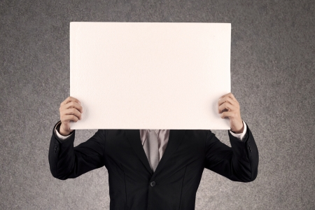 holding a sign: Businessperson with blank board that you can write anything