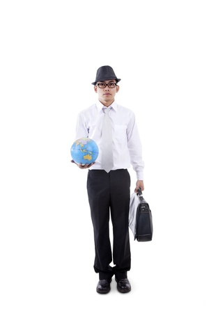 businessman carrying a globe: Young asian businessman holding globe and briefcase isolated on white