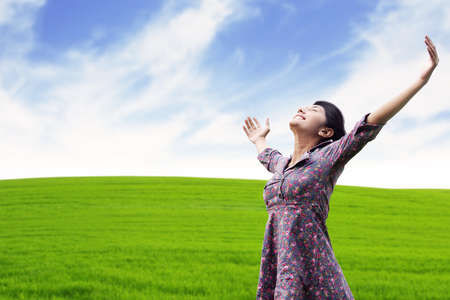 power yoga: Carefree woman having a good time at the meadow