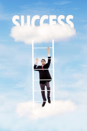 corporate ladder: Businessman climbing upward on the stair of cloud to get success Stock Photo