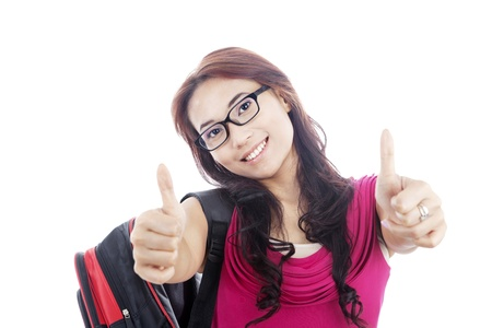 Portrait of asian college student showing thumbs-up. shot in studio isolated on white Stock Photo - 14683885