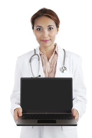 Asian doctor holding a laptop computer isolated on white photo