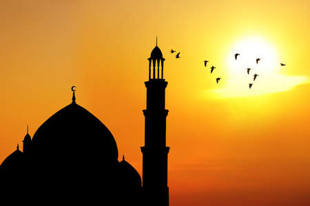 islamic wonderful: Silhouette of beautiful dome and minaret of mosque  shot at sunset