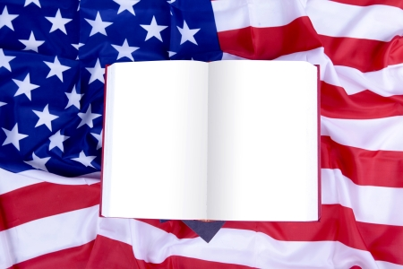 Open blank book on top of USA flag. Space can be used to add your own text photo