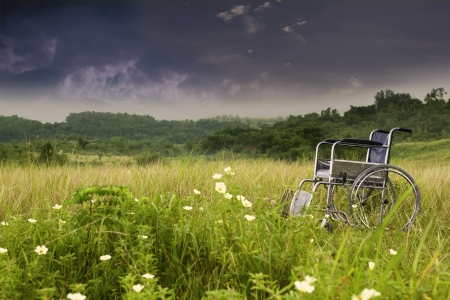 handicap: Empty wheelchair in nature symbolizing sadness and loneliness