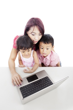 ultrabook: Young mother with her children using ultrabook laptop computer, can be used as internet education  Stock Photo