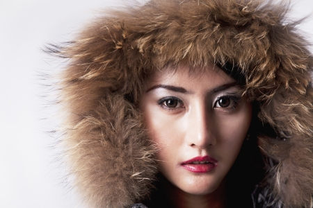 High fashion female model beauty shoot with fur jacket. shot in studio photo