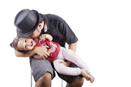 be kissed: Cute girl kissed by her father, can be used as a symbol of father affection