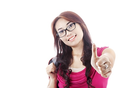 Portrait of asian college student showing thumbs-up. shot in studio isolated on white photo