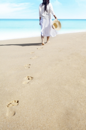 Shot of footprints with woman walks on the tropical beach. shot outdoor Stock Photo - 14684060