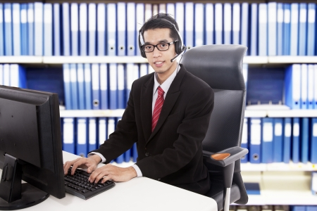 Young friendly customer service working at office photo