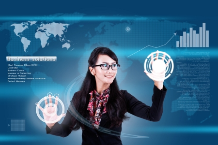 Attractive businesswoman navigating futuristic interface (outstanding business people in interiors / interfaces series)  Stock Photo - 14684386