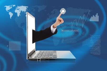 Hand out from laptop pushing a button on a touch screen interface Stock Photo - 14683921