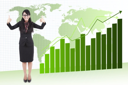 Attractive asian businesswoman showing two thumbs up to expressing her success in global business photo