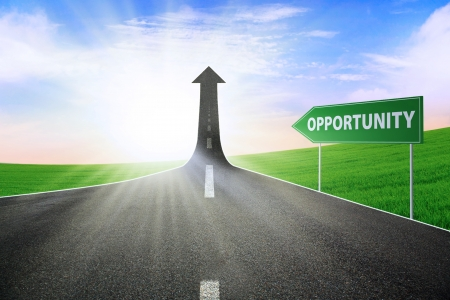 A road turning into an arrow rising upward with a road sign of opportunity, symbolizing the way to gain opportunity Stock Photo - 14683916