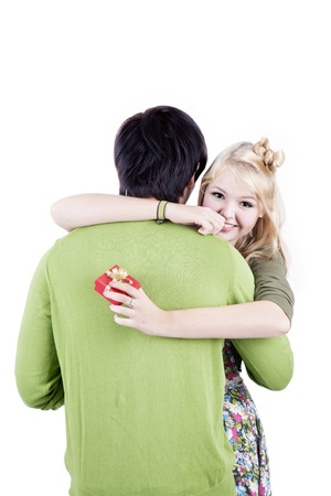 Happy beautiful young blonde woman get a present and hugging her boyfriend photo