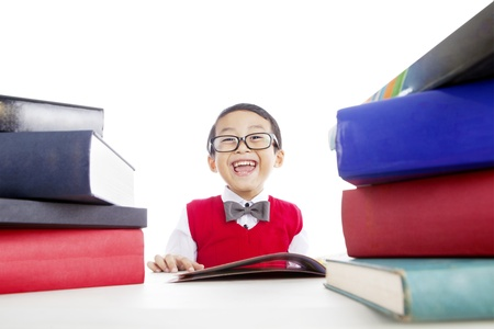 Portrait of elementary school student reading books. shot in studio Stock Photo - 14684325