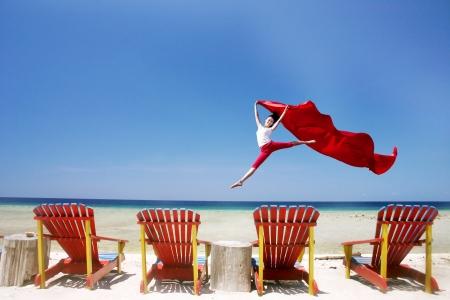 Woman enjoying the day at beautiful tropical beach photo