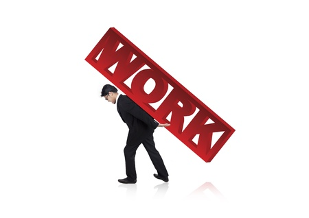 burdened: Businessman carrying a heavy work sign. Shot in studio isolated on white