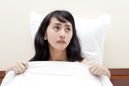 Pretty woman getting insomnia caused a nightmare Stock Photo