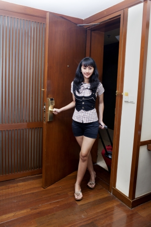 beautiful asian woman opening a hotel room photo