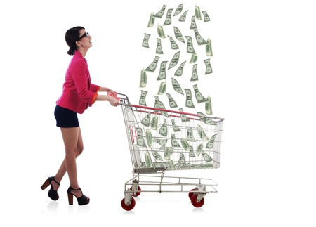 Lucky businesswoman catching raining money by using shopping cart photo